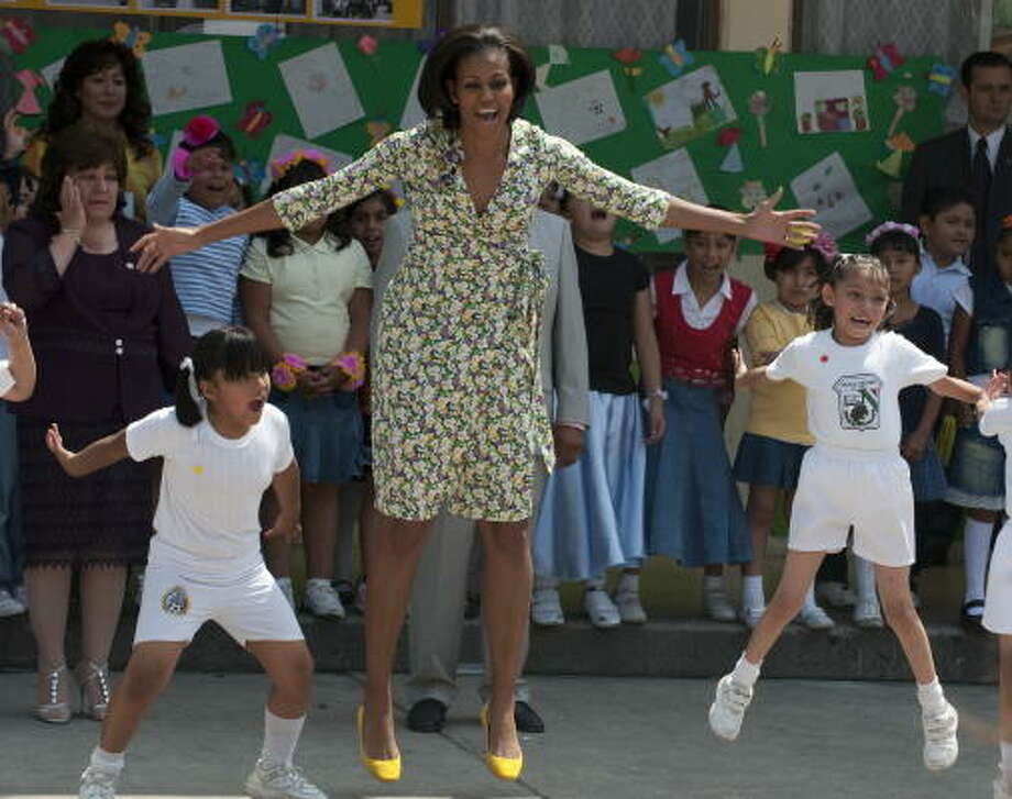 First lady Michelle Obama finds a moment Wednesday to play with children at a public school in Mexico City. Photo: OMAR TORRES, AFP/Getty Images