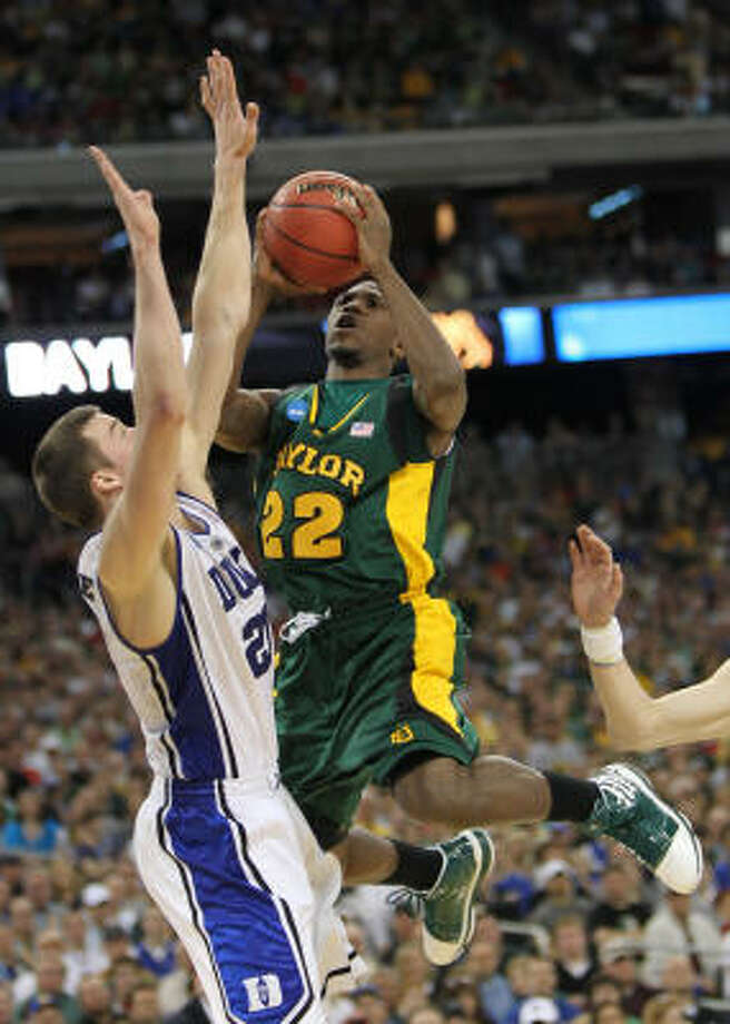 Baylor guard A.J. Walton drives to the basket in front of Duke forward Miles Plumlee. Photo: Nick De La Torre, Chronicle