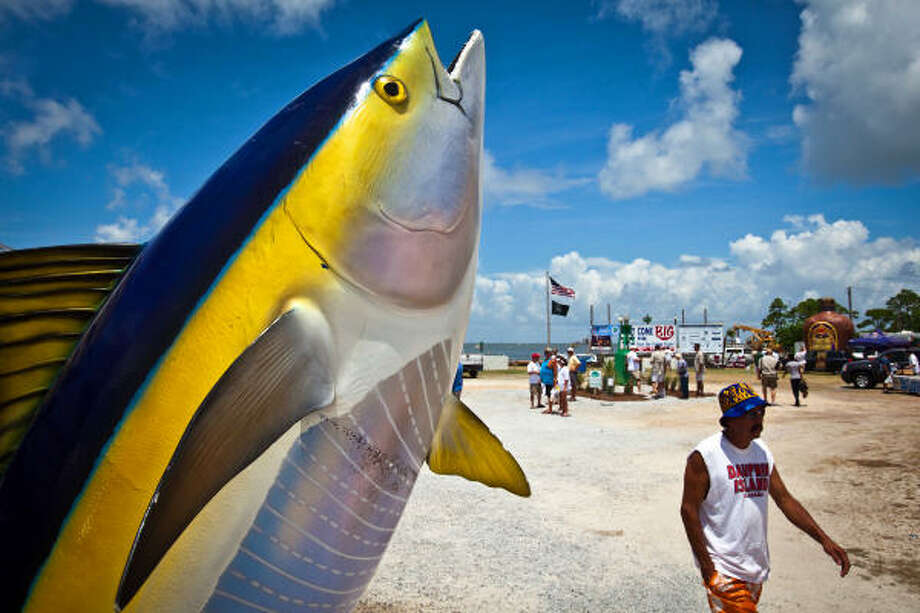 A sculpture of a yellowfin tuna outside a local gallery is one of the few fish in sight for visitors at The One That Got Away Community Day held Saturday on Dauphin Island, Ala. Photo: Smiley N. Pool, Chronicle