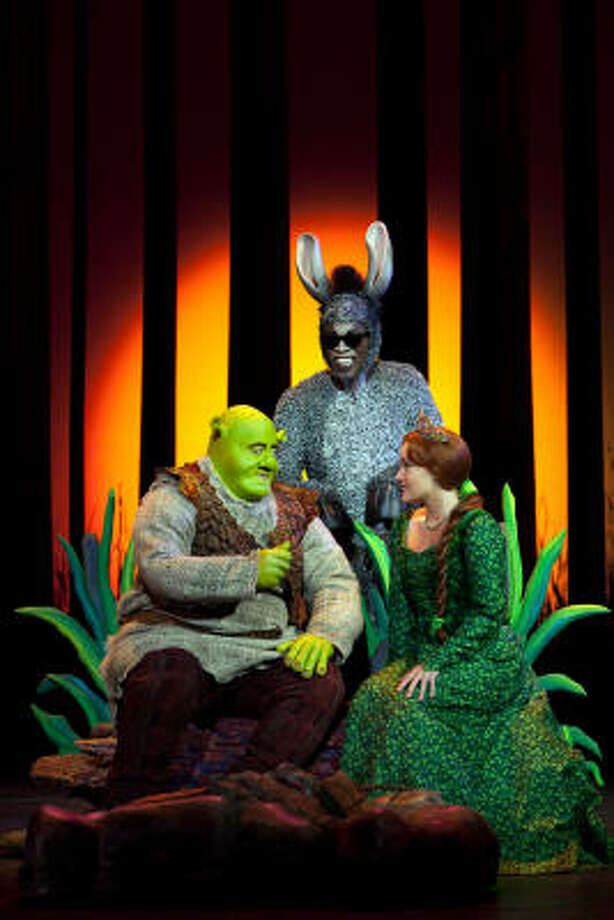 While the movie version allowed characters to show emotion through the computer animation, Eric Petersen (Shrek), Alan Mingo Jr. (Donkey) and Haven Burton (Princess Fiona) express themselves through song and dance in the musical. Photo: JOAN MARCUS