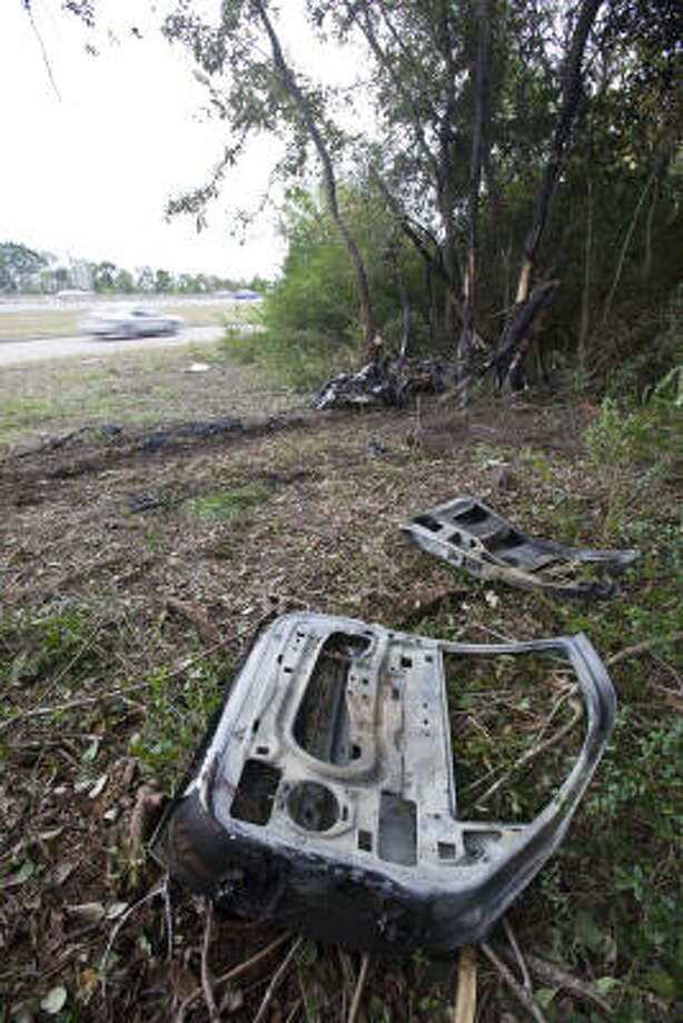 The remains of the accident lie off the Gulf Freeway in Webster on Sunday. Photo: Eric Kayne, Chronicle