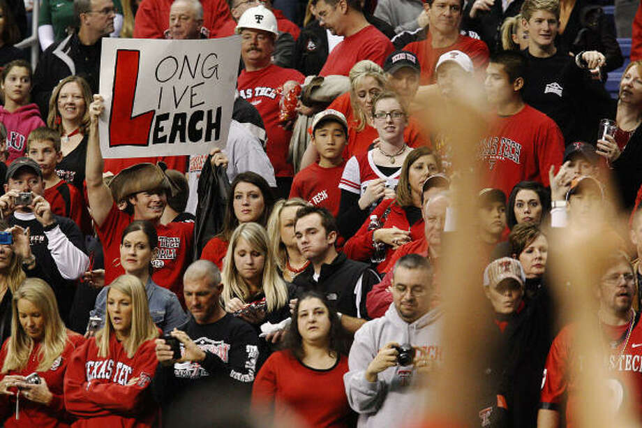 The support of fans and a history of success were not enough for Mike Leach to keep his job at Texas Tech. Photo: KIN MAN HUI, San Antonio Express-News