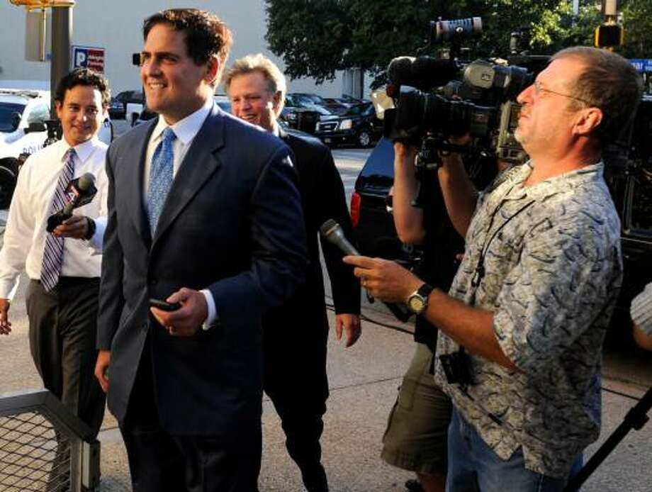 Dallas Mavericks owner Mark Cuban led a group  in bidding for the Texas Rangers. Photo: Cody Duty, AP