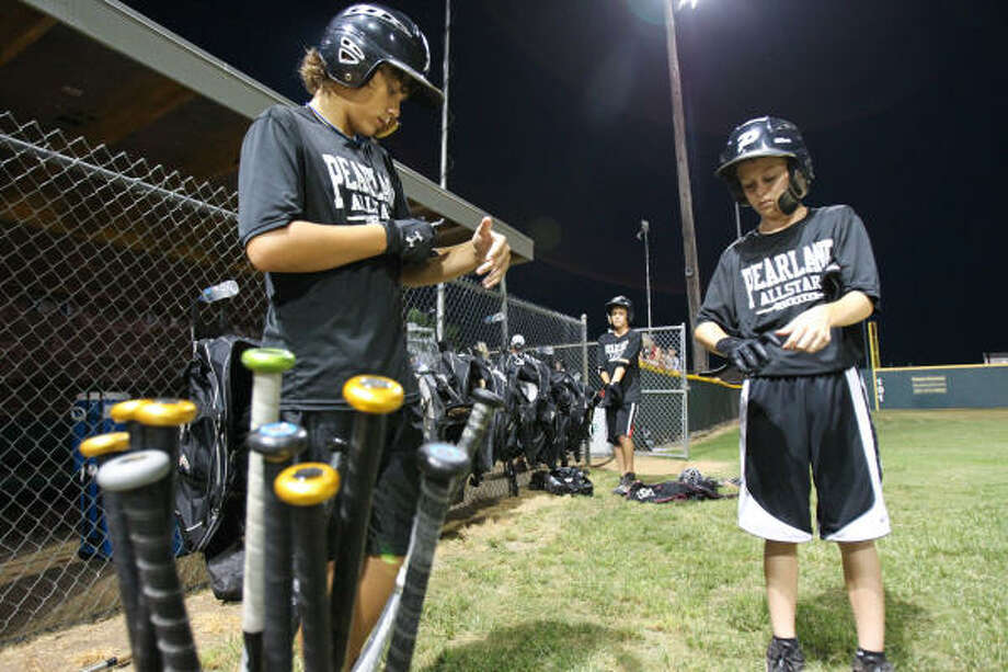 Mason Van Noort, left, and Hunter Smith prepare to take their cuts during batting practice a day after the Pearland team earned a spot in the Little League World Series. Photo: Nick De La Torre, Chronicle