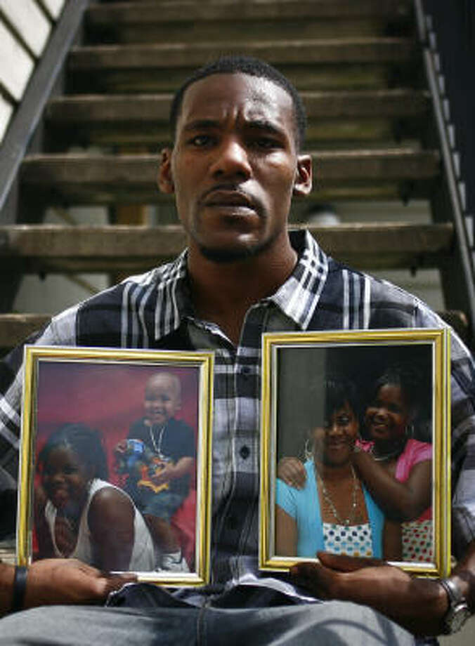 Christopher Jacobs, the stepfather of Shatavia Anderson, 14, shows family photos of the girl. Her body was found in a north Houston field on Saturday. Photo: Michael Paulsen, Chronicle