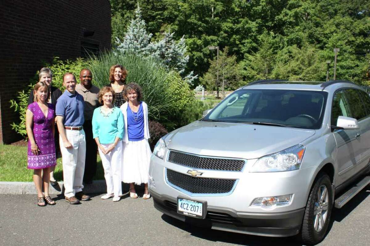 The New Canaan Community Foundation provided substantial funds, along with donor advised monies from the Dionne Fund and the Rein Family Fund, to fund the replacement of the adult day programís 10-year-old vehicle. Pictured from left are Cynthia Gorey, executive director of The New Canaan Community Foundation; Ilene Sumberg, Wavenyís director of the adult day program; Stephen Karl, vice president of KARL Chevrolet; Kevin Dupree, adult day program driver; Joan F. Dionne from the Dionne Fund; Heather L. Neff, Waveny CEO; and Joanne Boyer, Wavenyís director of development.