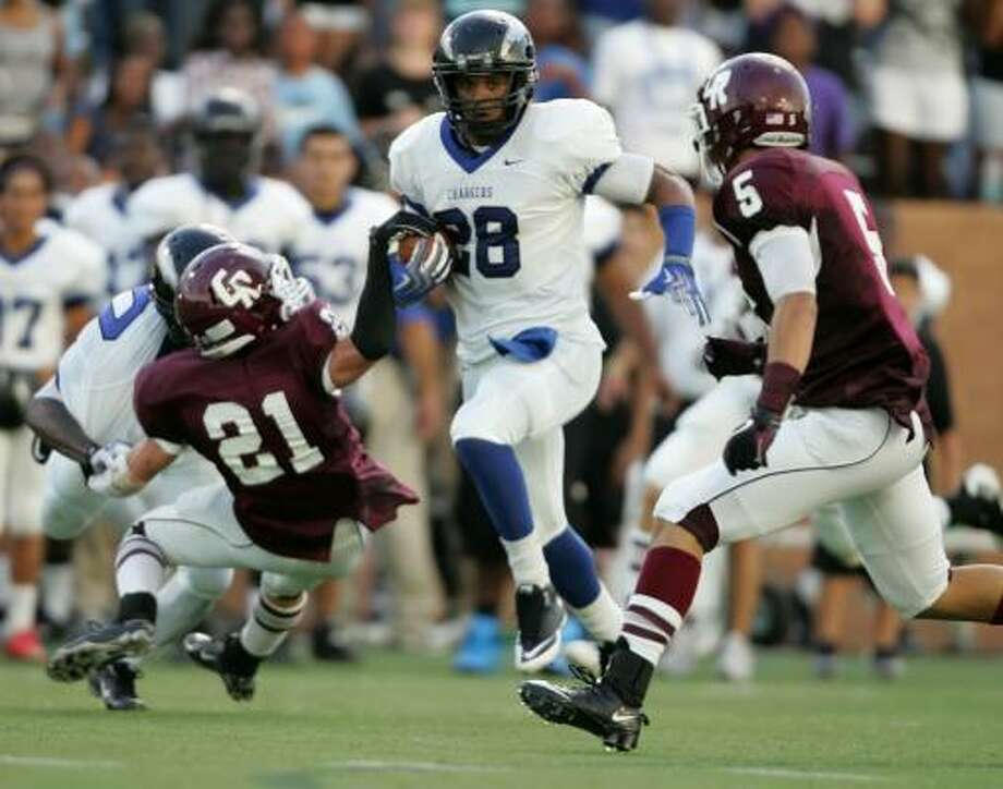 Clear Springs' Howard Matthews (28) leads his team in both rushing and passing. Matthews averages nearly 12 yards per carry. Photo: ERIC CHRISTIAN SMITH, For The Chronicle