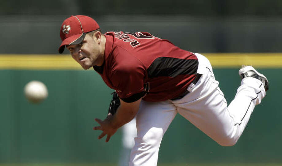 Wandy Rodriguez gave up nine hits and nine runs in 2 1/3 innings Wednesday. Photo: Charlie Riedel, AP File