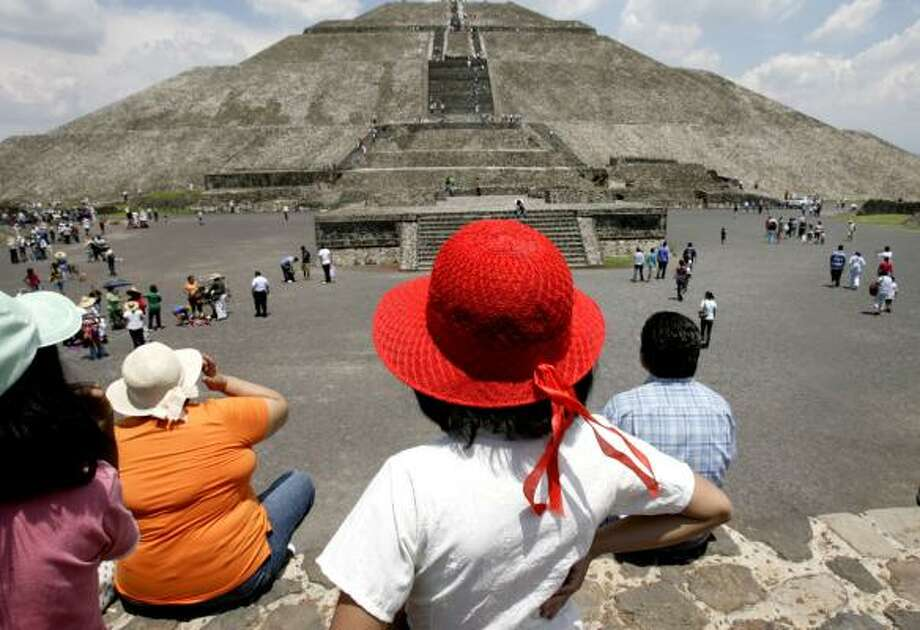 Visitors to the Pyramid of the Sun in Teotihuacán are said to receive a special energy of the site. Photo: Julio Cortez, Houston Chronicle
