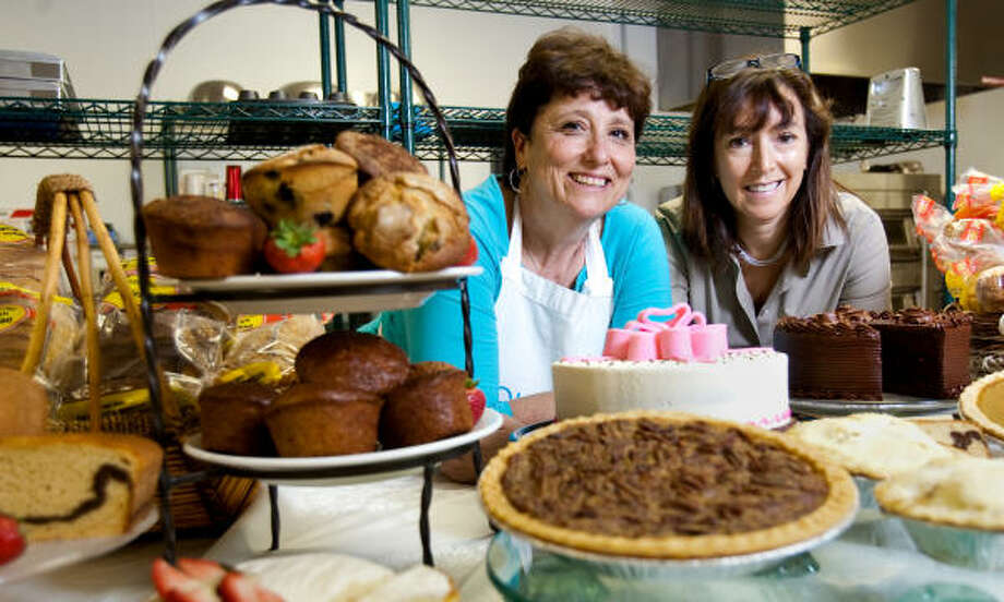 Julie Deering, left, and Randi Markowitz show what their company, Gluten Free Houston, can make without using wheat products. Photo: Nick De La Torre :, Chronicle