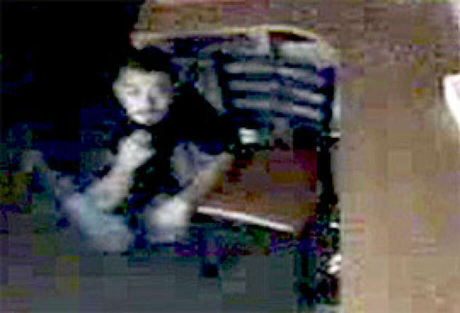 CAUGHT ON CAMERA: This photo taken from a surveillance video shows a man burglarizing the Pollos El Regio restaurant in Rosenberg last week. Police hope someone recognizes him. Photo: Rosenberg Police Department