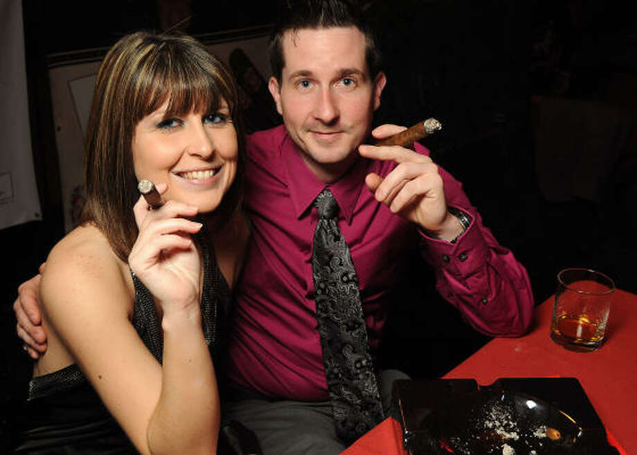 Marie Berg and Britton Douglass enjoy a fine smoke at the cigar patio at the Social Book's 2010 launch party. Photo: Dave Rossman, For The Chronicle
