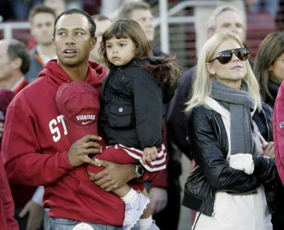 Tiger Woods with daughter Sam and wife Elin. Photo: Marcio Jose Sanchez, AP