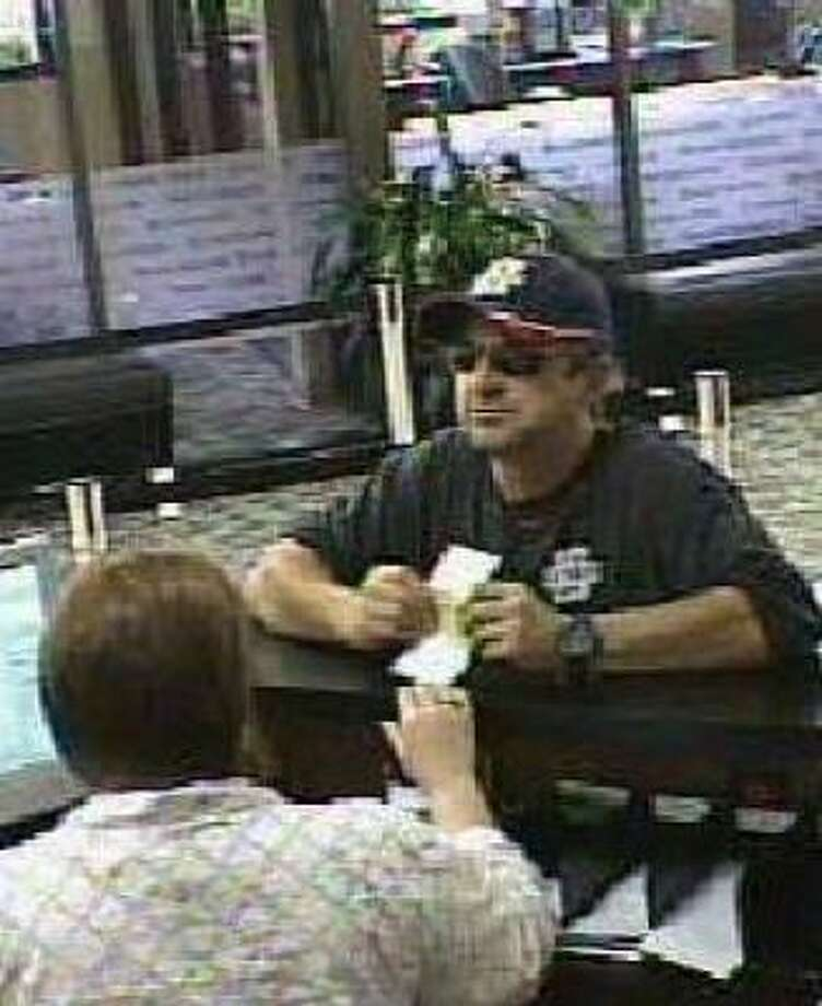 This image shows the man suspected of robbing a Capital One Bank in the 2100 block of Thompson Highway Saturday morning. Photo: FBI And Richmond Police