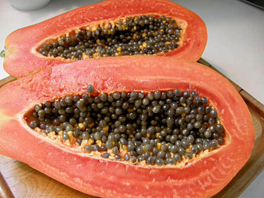 A papaya contains healthful vitamin C. Photo: Molly Glentzer, Houston Chronicle