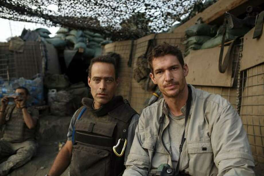Directors Sebastian Junger, left, and Tim Hetherington are shown at the Restrepo outpost in the Korengal Valley, Afghanistan, during the filming of their documentary, Restrepo. Photo: Outpost Films