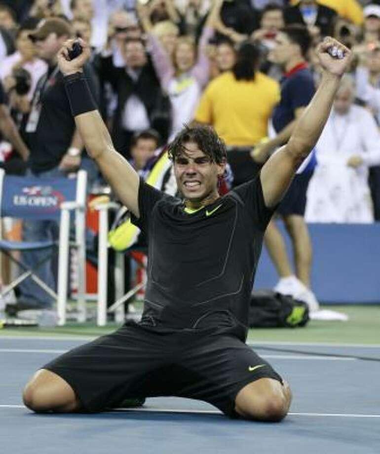 Rafael Nadal reacts after beating Novak Djokovic in the men's final on Monday night. Photo: Charles Krupa, AP