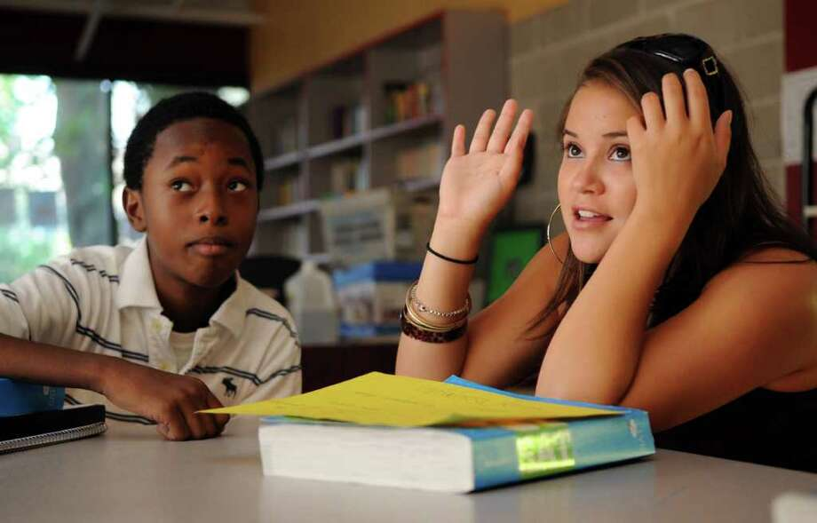 Jonathan Dorvil, 15, left, and Leann Moy, 17, right, work on solving a fill-in-the-blank vocabulary question during SAT preparation at the Boys & Girls Club in Stamford on Tuesday, August 2, 2011. Photo: Lindsay Niegelberg, Niegelberg / Stamford Advocate