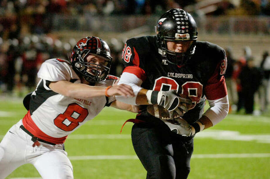 Coldspring's Caleb Shelly, right, breaks the tackle of Kirbyville's Caleb Cucancic to score a touchdown during the first half of their playoff game Friday at Lamar University. Photo: Valentino Mauricio, BEAUMONT ENTERPRISE