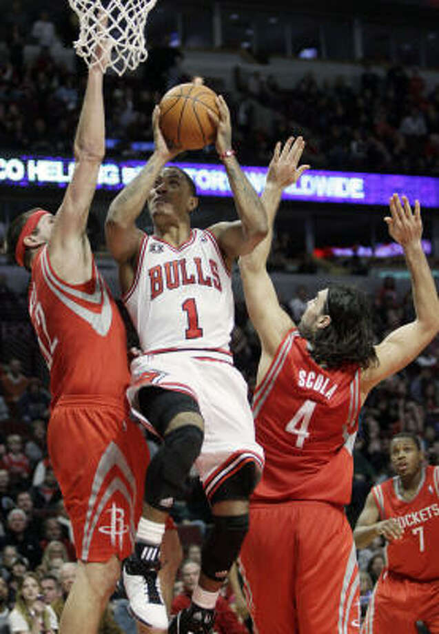 Bulls point guard Derrick Rose scored 30 points to help down the Rockets on Saturday night in Chicago. Photo: Nam Y. Huh, AP