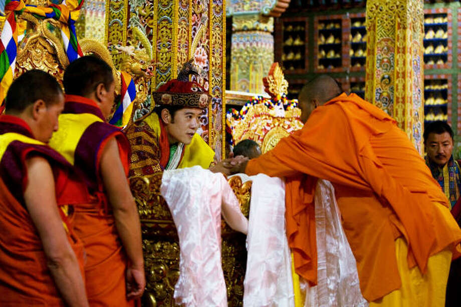 King Jigme Khesar Namgyel Wangchuck receives an offering in Thimphu, Bhutan. Religious culture defines all aspects of government and life in the small nation bordered by India and China. Photo: PAULA BRONSTEIN, GETTY IMAGES FILE