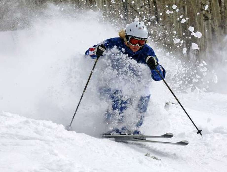 Seeking the smell of skiing after her sports psychologist urged her to engage her senses, freestyle moguls competitor Michelle Roark created a perfume that she felt captured that essence. Photo: Larry Pierce, AP