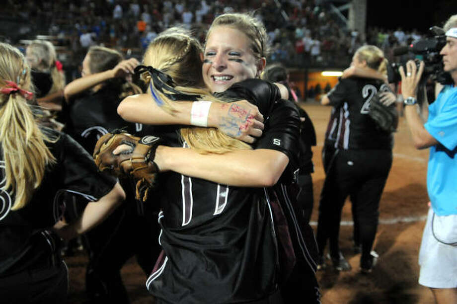 Pearland's Courtney Sams, rear, shares a hug with Stacie Pilkington after the win. Photo: Jerry Baker, For The Chronicle
