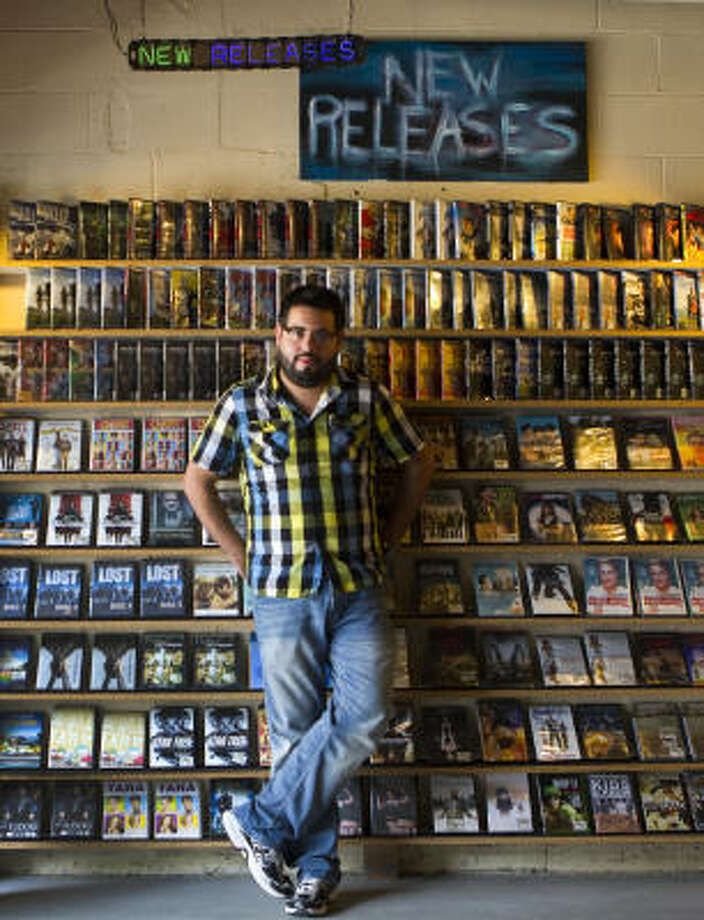 """Rob Arcos' Movies! The Store on Richmond goes on even as bigger chains nearby close. """"It's still scary,"""" he said. """"The store is still struggling, but it's a lot better than it was a year ago."""" Photo: Brett Coomer, Chronicle"""