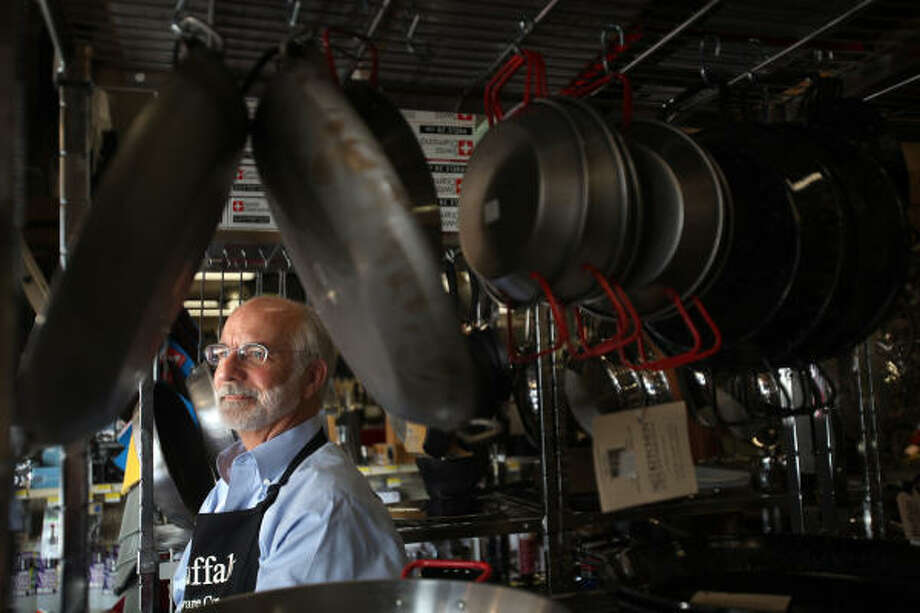 Jim Brown, owner of Buffalo Hardware, has a huge cooking department that includes cookbooks, cookware and supplies in a store that also sells nails, hammers and gardening supplies. Photo: Mayra Beltran:, Chronicle