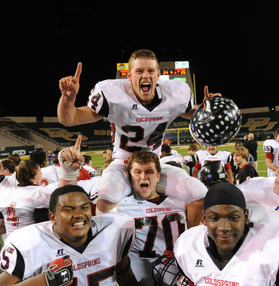 Coldspring's Cody Cummings (24), Kevin Leach (70), Joseph Traylor left and Sherman Gilbert celebrate the semifinal victory. Photo: Rod Aydelotte, For The Chronicle