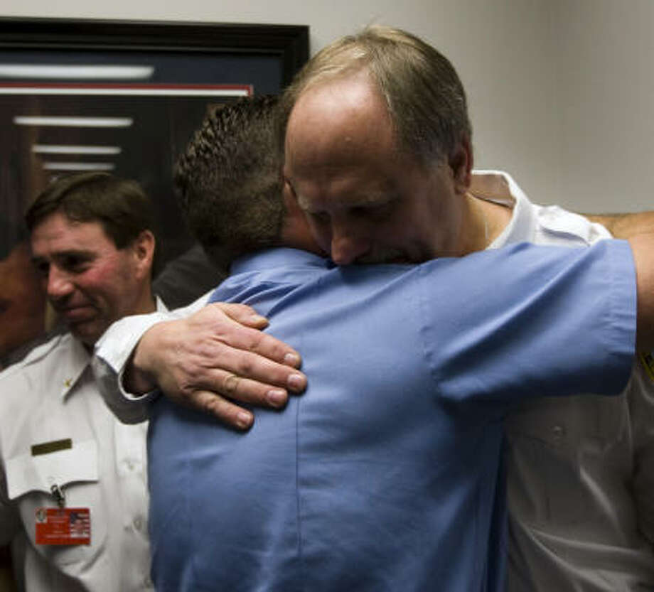 "Houston Fire Chief Phil Boriskie embraces a fellow firefighter on Tuesday. ""I will say with conviction that the Houston Fire Department will prevail from attacks, from critics who do not know all the facts,"" he said at his news conference. Photo: Brett Coomer, Chronicle"