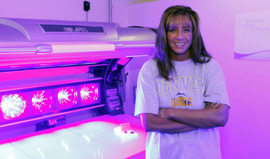 Cherry Creek Tans owner Kristi Alpers said the tax on the indoor tanning industry is an attempt to shut it down. Photo: Ed Andrieski, AP