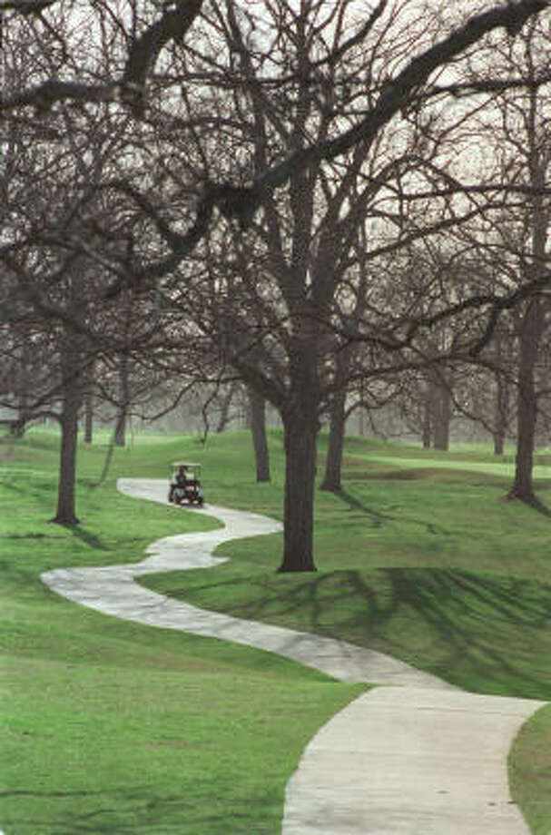 Mature pecan trees give River Ridge the feel of a storied course, even though it's less than 12 years old. Photo: E. Joseph Deering, Chronicle