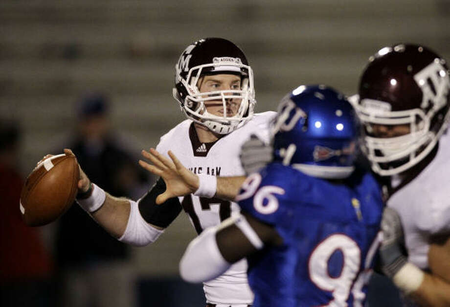 Texas A&M quarterback Ryan Tannehill had three touchdown passes in Saturday's win. Photo: Orlin Wagner, AP