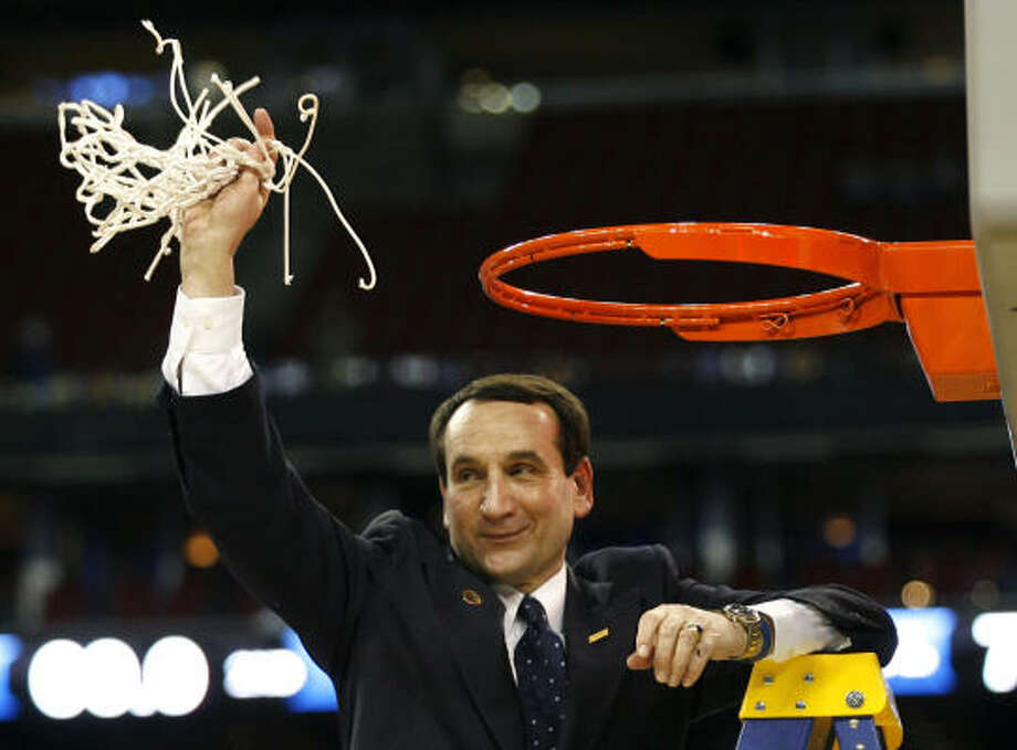 Although Duke coach Mike Krzyzewski is no stranger to cutting down nets, he maintains it's not as easy as his basketball program makes it look. Photo: James Nielsen, Chronicle