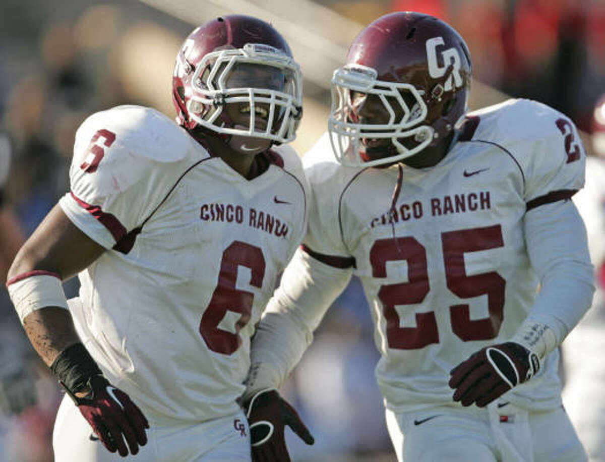 Cinco Ranch's Jamel James (6) and K.C. Nlemchi celebrate James' 1-yard touchdown carry during the fourth quarter on Saturday.