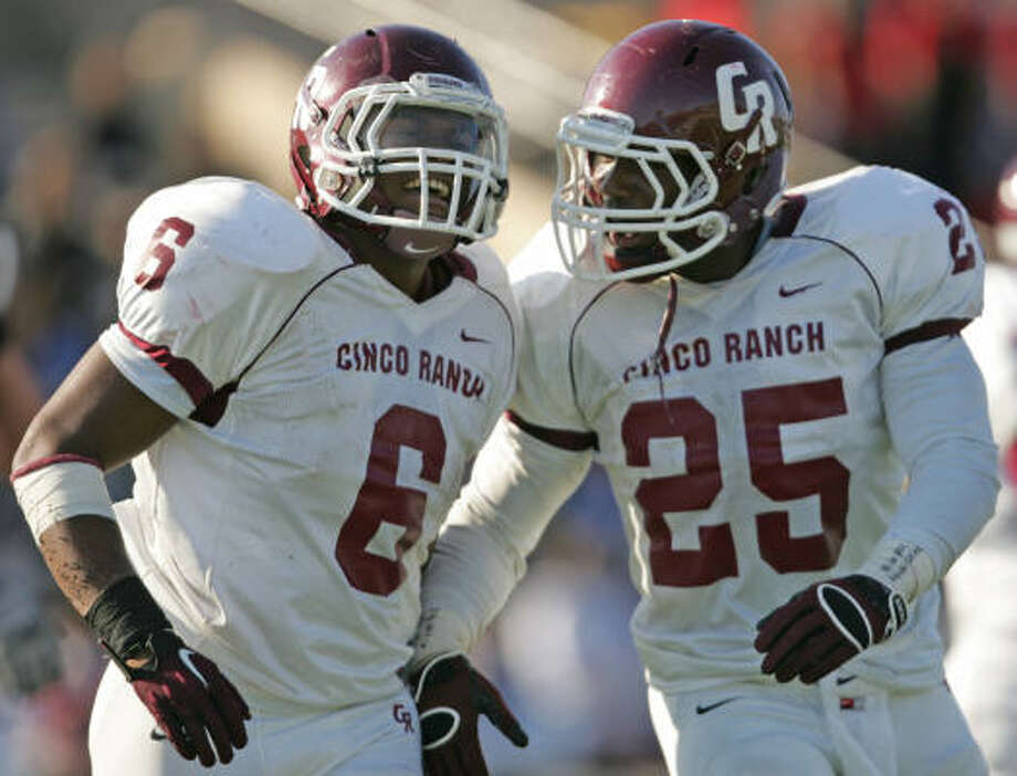 Cinco Ranch's Jamel James (6) and K.C. Nlemchi celebrate James' 1-yard touchdown carry during the fourth quarter on Saturday. Photo: ERIC CHRISTIAN SMITH, FREELANCE
