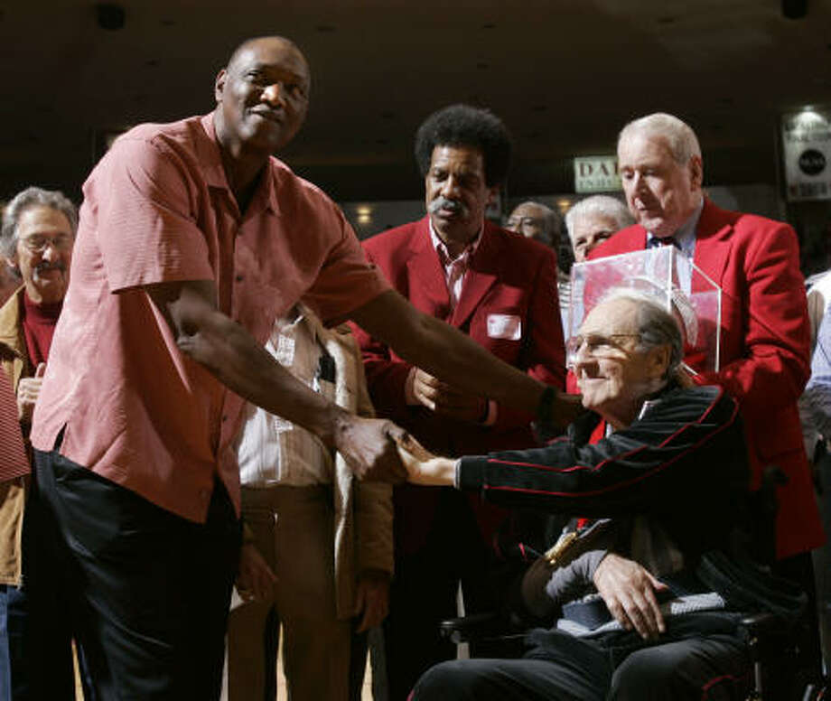 Former UH star Elvin Hayes, shown here with former coach Guy V. Lewis (right), is joining the school's radio broadcast team. Photo: Brett Coomer, Chronicle