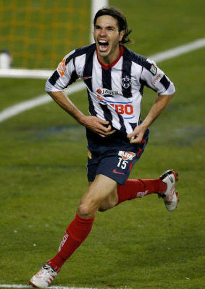 Monterrey defender Jose Maria Basanta celebrates his game-tying goal in injury time. Photo: Julio Cortez, Chronicle