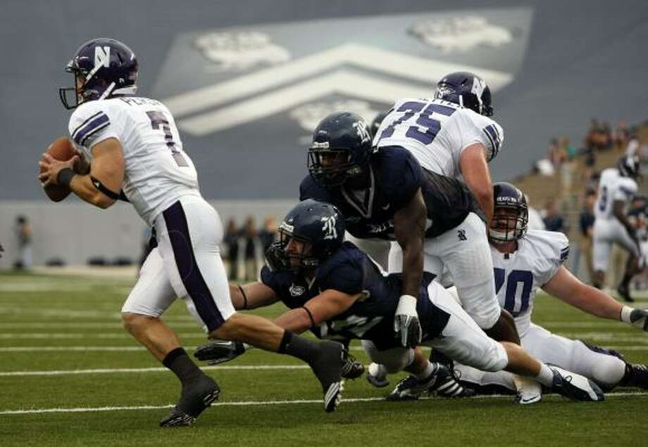 Rice defensive end Kramer Lucio, center, has 13 tackles and leads his team with two sacks. Photo: Johnny Hanson, Chronicle