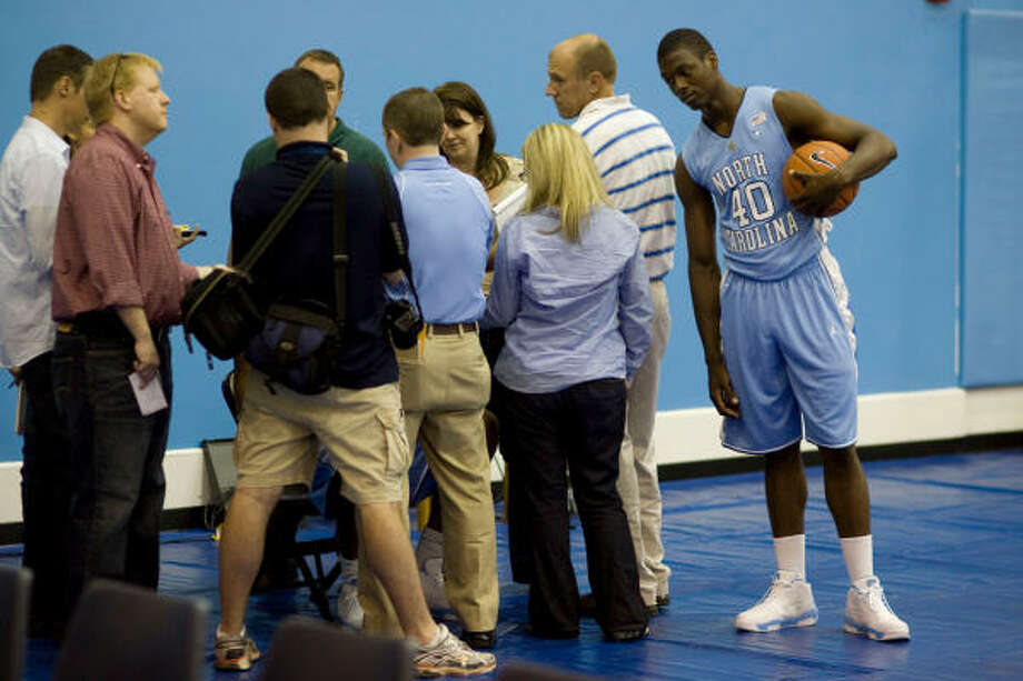 Harrison Barnes, right, may be on the outside listening in as reporters surround North Carolina teammate John Henson during the Tar Heels' media day, but Barnes will receive plenty of attention this season. He's considered by many to be the best freshman in the nation. Photo: Robert Willett, AP