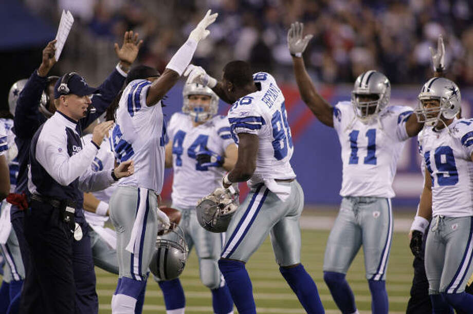 Cowboys wide receiver Dez Bryant (88) and new interim head coach Jason Garrett, far left, celebrate Bryant's first-quarter touchdown against the Giants during Sunday's win. Photo: Paul Moseley, MCT
