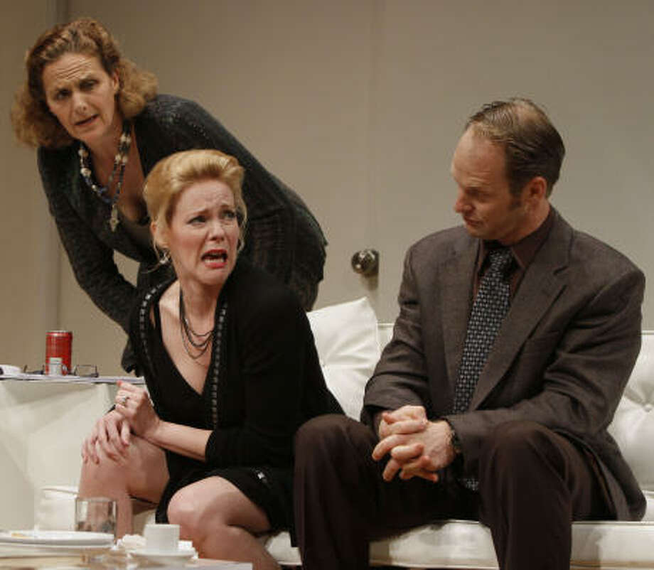 Amy Thone, from left, plays Veronica Novak, Bhama Roget plays Annette Raleigh and Denis Arndt plays Alan Raleigh in God of Carnage. It runs at the Alley through Jan. 30. Photo: Chris Bennion