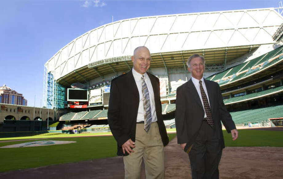 Astros manager Brad Mills (left) and general manager Ed Wade downplayed the impact of a possible sale. Photo: Brett Coomer, Chronicle