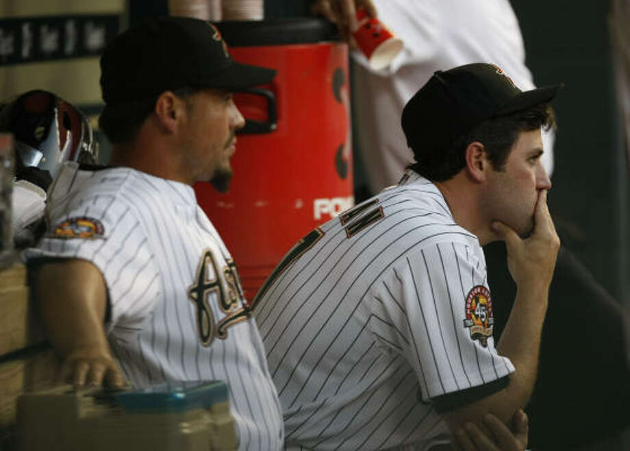 Lance Berkman, right, was placed last Wednesday on the 15-day disabled list, retroactive to March 26, when the knee swelled after a workout. Photo: Julio Cortez, Chronicle