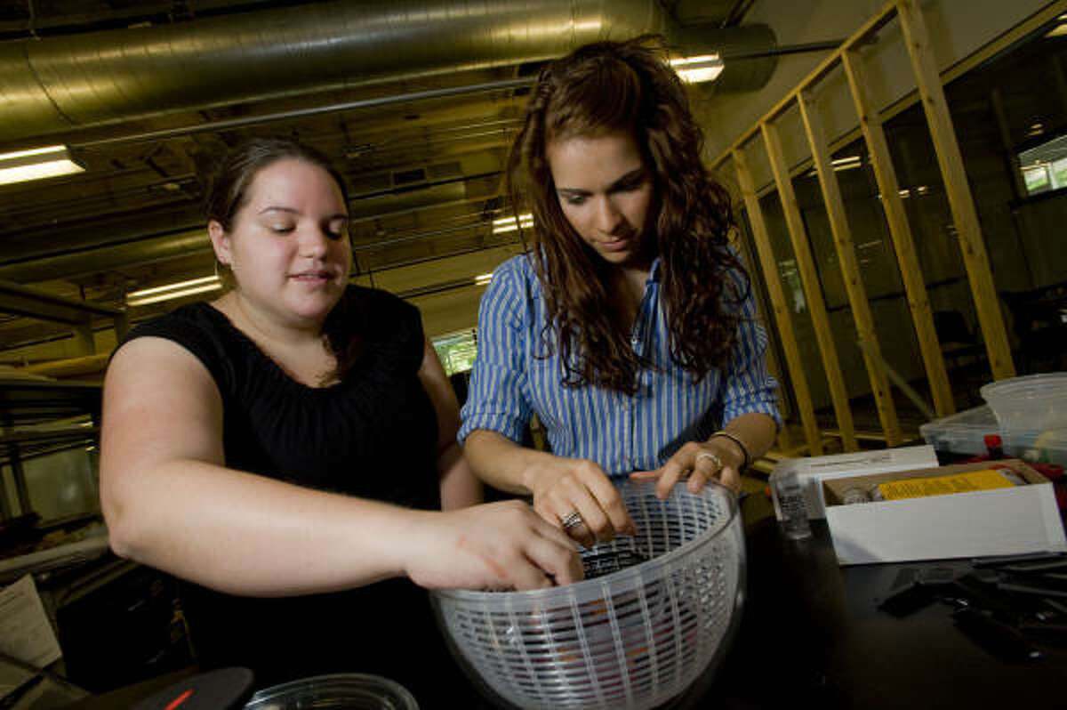 """Rice University undergraduates Lila Kerr, left, and Lauren Theis assemble a """"Sally Centrifuge,"""" a low-cost device that could help doctors diagnose anemia in rural parts of the world."""