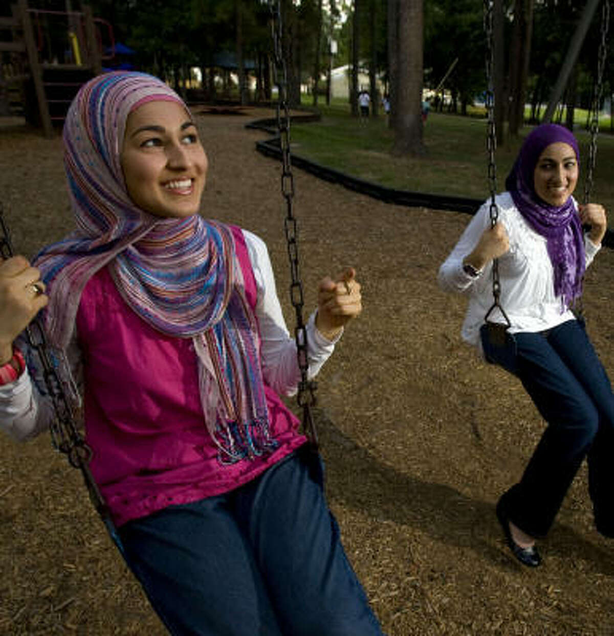 Sisters Huda, 21, left, and Wardah Khalid, 24, of Spring, said they and their sister, Thuba, 19, decided last summer to wear the hijab after attending a Muslim conference.