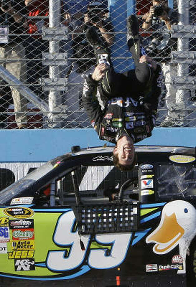 Carl Edwards does a flip after winning the NASCAR Sprint Cup Series auto race at Phoenix International Raceway on Sunday. Photo: Jason Babyak, AP