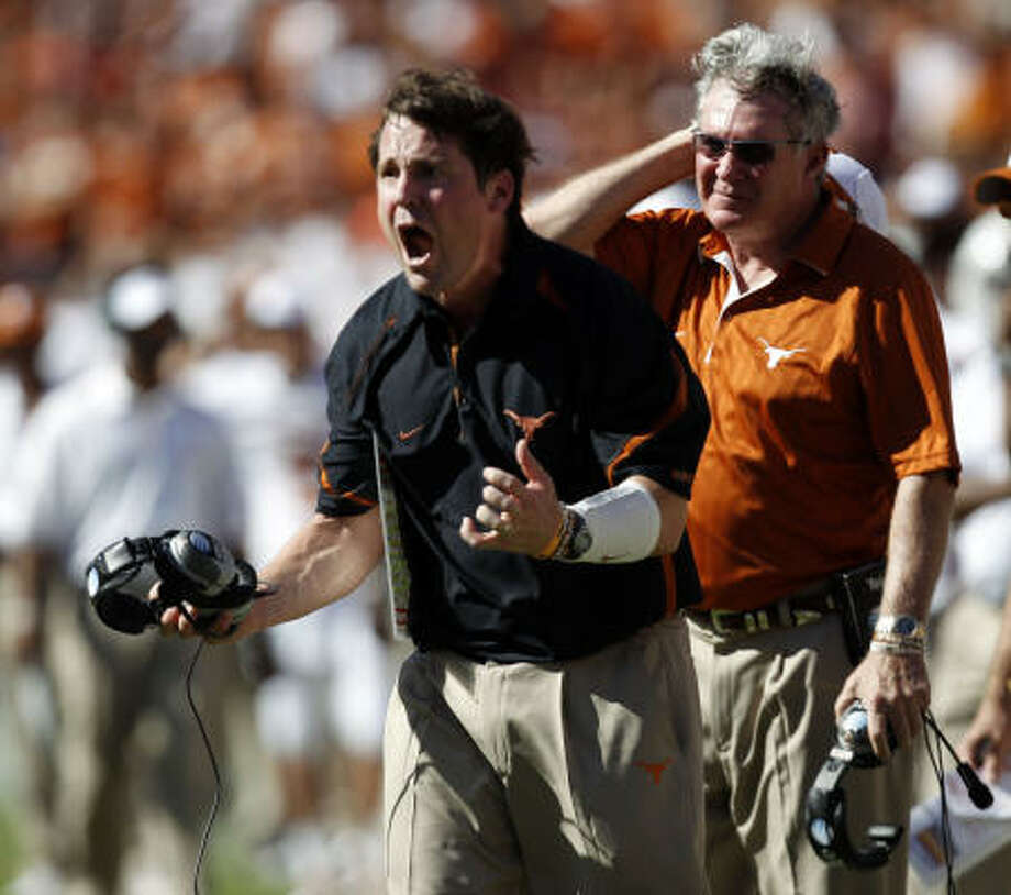 Will Muschamp's exit just five days after three embattled assistants retired or resigned led to calls for Mack Brown, right, to act immediately. Photo: VERNON BRYANT, Dallas Morning News