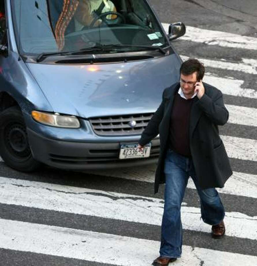 "Crossing a street can be risky for pedestrians talking or texting on cell phones. Researchers have a term for the result — ""inattention blindness"" — and say it's getting worse. Photo: RICHARD PERRY, New York Times"